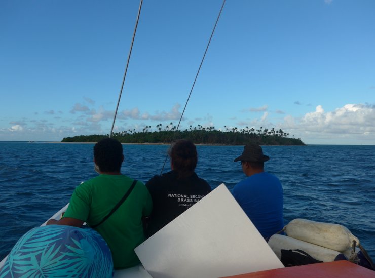 Approaching Fafá Island in the launch at sunset with three of our fellow travelers sitting on the top of the cabin.